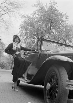 Woman with a Buick car,c.1932 by Zoltan Glass