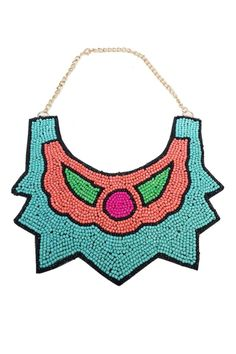 Gorgeous hand beaded necklace features bright colors perfect for the spring and summer seasons! Pair with a simple blouse or dress for a chic trendy look!   Beaded Bib Necklace by Glam Squad Shop. Accessories - Jewelry - Necklaces - Statement Necklaces Las Vegas