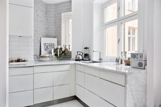 modern white kitchen and white painted brick wall