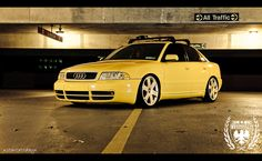 "Slammed Imola Yellow B5 S4 Chris's awesome Audi B5 S4 sitting ridiculously low on a set of 18"" B6 S4 wheels."
