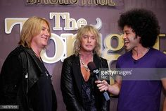 LENO Episode 4262 Pictured Musical guests Def Leppard Joe Elliott Rick Savage talk with Bryan Branly backstage on June 4 2012