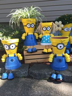 Minions Minion Boy Minion Girl Clay Flower Pot, Minion Characters Flower Pot People, Clay Pot People Planters  Description This Garden Friends listing is for a Minion, boy, girl or both....clay pot person made from terra cotta pots. These cute characters would brighten up any garden or front porch. They would also make a great decoration for a Minion themed Birthday Party. We can write Happy Birthday Tyler on them or any name of course. The minion girl comes with straw hair & the boy can ...