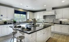 This sleek kitchen from @LennarCACoastal features classic white cabinets and a complementing #backsplash