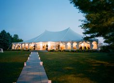 lanterns on the pathway to tented wedding reception