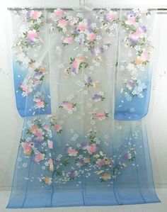 This is a glamorous organdy Uchikake with charming 'Sakura'(cherry blossom) design, which is dyed allover. Its transparent feeling is attractive. This piece should be worn over Kakeshita Furisode as usual Uchikake