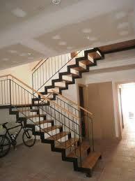 Resultado de imagen para escaleras de madera con baranda de hierro