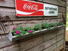 Coca Cola Sign with Chicken Feeder as Flower Container with Impatiens and old Rusty Pitchforks as Barn Decor...'