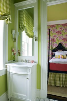 I like the apple green and white together.  ~MAA ...Small spaces call for simple solutions. In a Washington D.C. Design Center Showhouse, designer Victoria Neale tucked a crisp white vanity with bowed front next to the door of a charming girl's bedroom. Narrow, shaded sconces mounted on the mirror frame are functional and fashionable; apple-green walls and a checked valance add pops of color.