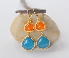 Large Teal Teardrop and Orange Teardrop Glam Dangle Earrings. Fall Fashion Earrings. Teal Orange Glass Earrings. via Etsy.