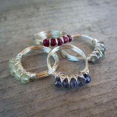 Ruby, prehnite, iolite, and labradorite rings by mcfarlanddesigns, via Flickr