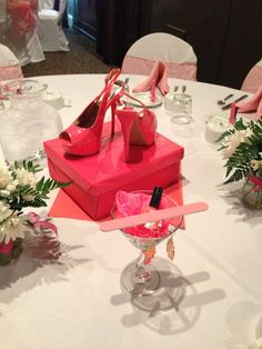 Stiletto shower-tini: centerpiece/gift for the bride. Shoes, jewelry and nail polish in matching colors. Doubles as great decor and great gift! Unique bridal shower theme :)