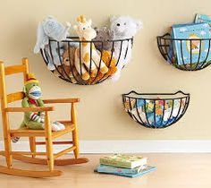 Use hanging plant baskets to store baby toys for easy access.