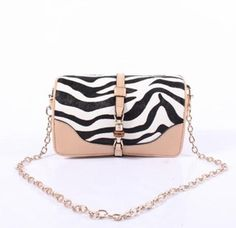196ad0088b4a Gucci Zebra Broadway Evening Bag  1200.00 from Queen Bee of Beverly Hills  Gucci Handbags