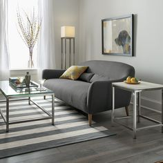 London-based designer Bethan Gray's sleek curves flare out to invite you in to this affordable furniture collection for small rooms and apartments. A textured, linen-blend weave hugs every turn of the sofa's graceful tight back and plush seat with two kidney pillows to support your lower back.