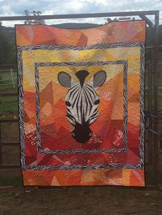 "Made by Kristina Hambly via Quilt Club Australia on FB.  ""Finished the binding (finally) on my king single zebra quilt.  The centre is a 40"" paper pieced pattern by tartan kiwi the rest is by me."""
