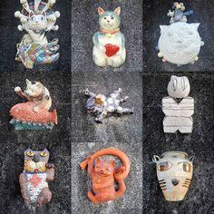 とこなめ招き猫通りのまねきねこ The fortune cats Manekineko on the roadside wall in Tokoname. All of them are made by pottery and are different designs. #常滑#とこなめ招き猫通り #常滑焼 #招き猫#猫#陶器 #tokoname #manekineko #pottery #cat #fortune #japan