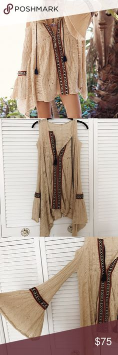 For the Love of Flowers Free People tunic Gauzy crochet tunic with open shoulder, dramatic bell sleeves, and tribal inspired embroidery. It's really stunning on. I wore it maybe 3 or 4 times but always got a ton of compliments because it's so unique. It has only ever been dry cleaned and is in great condition Free People Tops Tunics
