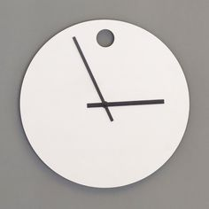 Zero Hour Clock by Group Design: A simple circular white clock with cutout detail to mark 12 o'clock.