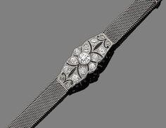 A belle époque diamond-set bracelet, circa 1915 The finely pierced navette-shaped plaque millegrain-set throughout with old brilliant and rose-cut diamonds, to an adjustable mesh-link bracelet strap