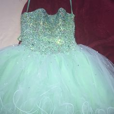 Mint green formal dress. Two years old. very tiny hole in the mesh (not noticeable). Laces in the back. Gems on the top.  Good condition, worn once. Dresses
