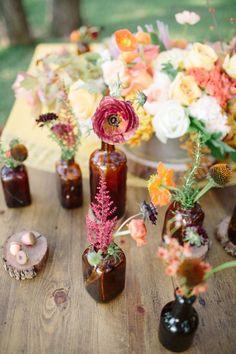 Single stem floral arrangements colorful flowers pretty wild glass rustic table vase