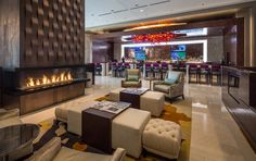 Our lobby features an open-concept lounge with fireplace and our Prairie Fire Bar as well as access to our outdoor patio featuring a life size fire pit. #hiltongranitepark #hiltondpgp #travel #weddings #dallas #plano #texas #hotel