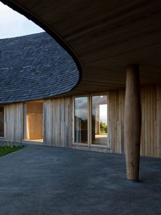 Pezo Von Ellrichschausen has completed a semi-circular house perched on a hilltop on Chile's Chiloe Island which features a slanted shingle-clad roof.