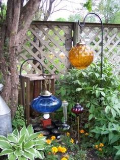 Here's one of my favorite garden junk projects ever: hanging glass globes. These beautiful glass pieces started life as table and swag lamps from the 60's or 70's, which were thrift store finds. I took them apart, then simply put them back together in a way that allowed them to hang from the shepher...
