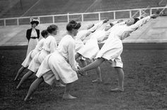 Denmark's women gymnasts practice at the 1908 London Olympics. Note the thick cotton lisle stockings and wrist length sleeves.