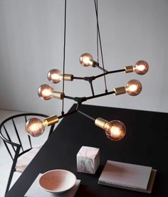 A great vintage and stylish range of lighting with black tubular stems and brass detail - great prices too. Pendant Lamp, Pendant Lighting, Chandelier Lamp, Ceiling Light Design, Ceiling Lights, Living Styles, Light Table, Messing, Hanging Lights