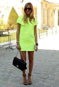 I love this neon colour and the shape of the dress, effortless.