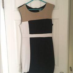 Color block dress Cream, white, and black color block dress. 3% spandex, 97% polyester Dots Dresses