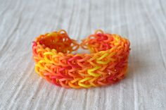 Rainbow Loom bracelet made from hot colors, red, orange and yellow. ArtyCraftySudio on Etsy