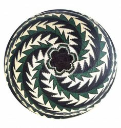 Swirls of perfectly stitched green and black feathers climb the sides of this masterpiece and end perfectly pointed at the top.