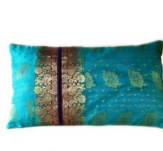 Wrapped up peacock blue with gold trim saree.