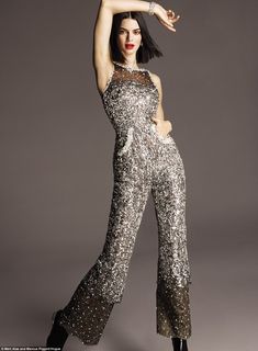 Silver touch: Inside the magazine she wears outfits that sparkle. One is a silver sleevele... #kendalljenner
