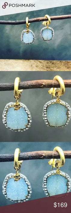 Handmade Blue Druzy earrings pave with Swarovski One of my signature pieces. A stunning blue Druzy earrings pave with Swarovski crystals and hanging on organic formed 24 karat , matte  gold coated hoops. Hi are sure not to see these anywhere else. If you're tired of seeing the same things all over the place, these are the ones for you. Matana Jewelry Earrings