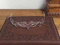 Beautiful Elven circlet made from metal wire with wire wrapping accents. Perfect addition to any outfit or costume. Item can be secured using hair clips or a ribbon. A chain can be added to the back for free if requested upon checkout.   These pieces are hand made to order and will have