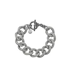 All dressed up and everywhere to go. We sprinkled this classic chain-link bracelet with ultra-sparkly pavé stones for opulent appeal, then finished it with an easy toggle closure. Let it add a little extra elegance to everything from office ensembles to special occasion statements.