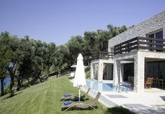 Akrothalassia Kalamaki, Perithia & Agios Ioannis Sleeps up to 4. An exceptional choice for two couples, the peaceful villa is the last word in indoor/outdoor living and benefits from a sunbathing deck perched just above the sea, as well as steps into the water.