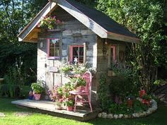 Don't know whether it is a playhouse or a potting shed or something else altogether, but it is cute!