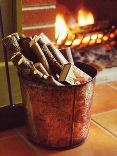 A bucket full of wood and a warm fire on a cold night. Perfect!