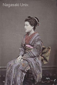 Portrait of a woman sitting in a chair, about 1880's, photographer Usui Shuzaburo