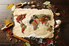 spices of the world: Map of world made from different kinds of spices on wooden background