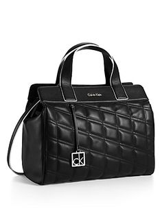 a tonal quilted pattern and extended top zip closure in a structured style with dual handles and a shoulder strap.
