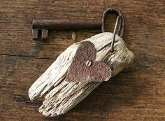 Rusty and romantic: a piece of driftwood and a rusty piece of tin make a key ring for your favorite place
