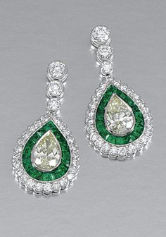 PAIR OF EMERALD AND DIAMOND EAR PENDANTS. Each centring on a pear-shaped diamond of yellow tint within surrounds millegrain-set with French-cut emeralds and brilliant-cut diamonds, suspended from three similarly set brilliant-cut diamonds, post and butterfly fittings.