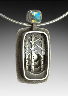 Nature themed sterling silver shadowbox pendant by Suzanne Williams. | via suzannewilliamsjewelery.com