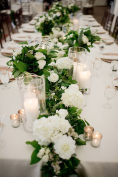 green and white floral and candle table runner