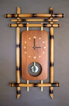 """Time Flies""  W 23"" x H 38"" x D 2""  Artist: Cal Hashimoto  Bamboo, mahogany, Seiko pendulum clock movement.  Price: $1,000."